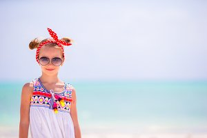 Portrait of adorable little girl on beach summer vacation