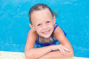 Closeup little beautiful girl in outdoor swimming pool