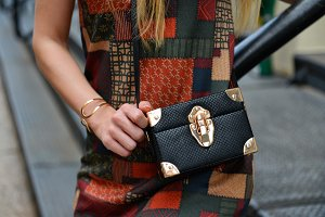 Woman with Black leather clutch bag