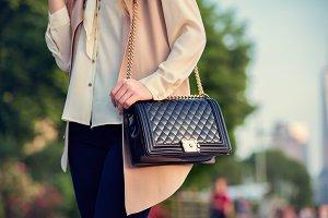 Woman carrying elegant purses bag