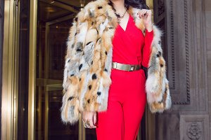 woman wearing luxury fur outfit