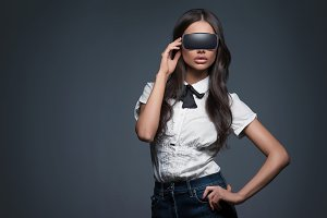 woman and virtual reality goggles