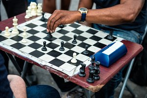 hands of people plaing quick chess