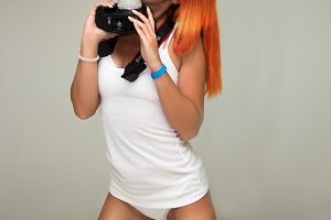 Sensual woman kiss camera lens