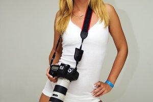 Sensual woman with camera