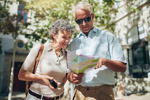 Senior couple looking at a map