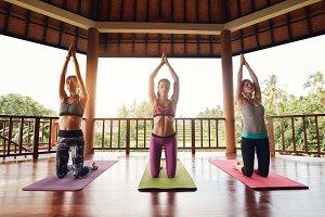 Three young women doing yoga
