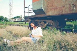 A traveler relaxing on grassland