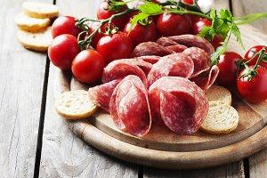 Fresh salami with tomato