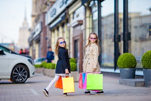 Adorable little girls on shopping outdoors
