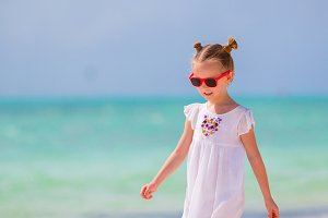 Little adorable girl at beach during summer vacation
