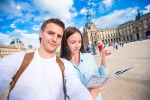 Happy young couple taking selfie on european vacation