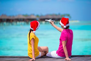 Couple in Santa Hats on a tropical beach at Maldives