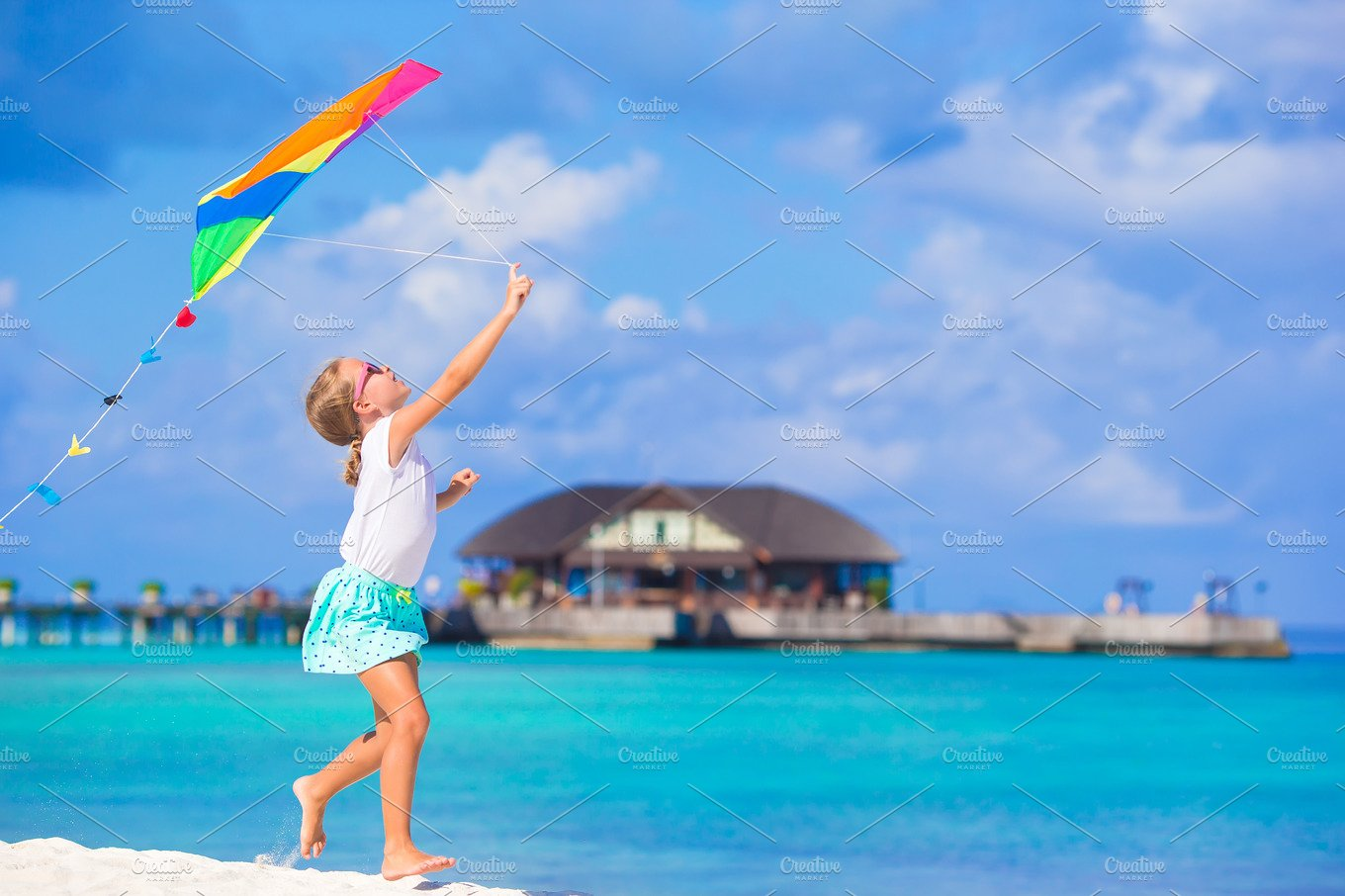 Little Cute Girl Playing With Flying Kite On Tropical Beach People Photos Creative Market