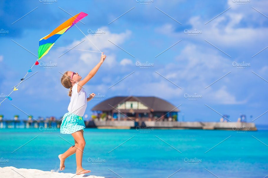 Little Cute Girl Playing With Flying Kite On Tropical Beach