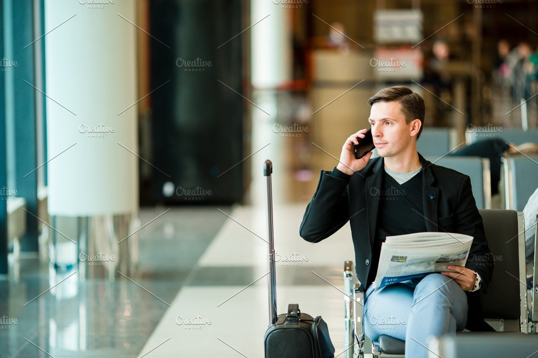 69a8ff18e26 Urban business man talking on smart phone inside in airport. Casual ...