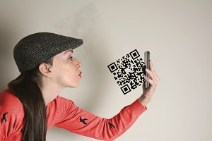 Qr code, woman sends a kiss, concept