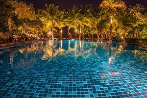 blue swimming pool at night