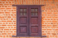 Vintage window on Red brick wall