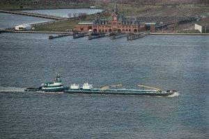 tugboat pushing barge on river