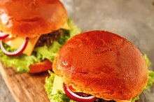 homemade veggie burger in a bun with sesame seeds of beer. delicious fast food for vegans. on  wooden background