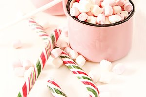 Homemade white hot chocolate with marshmallow on a light background. The area of the image with selective focus. Romantic Christmas breakfast