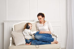 Mother and daughter. Listen to music