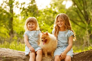 Little girl hugging Spitz