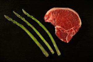 Raw Steak with green asparagus