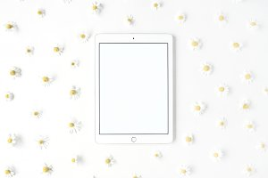 Tablet and chamomile pattern