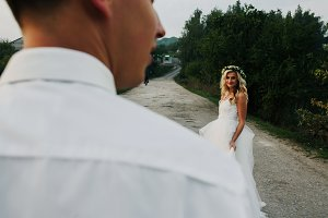 bride leads groom on the road