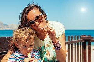 family eating an ice cream at beach