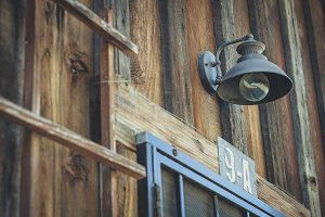 Industrial lamp on wood wall