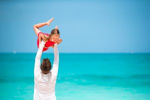 Happy father and little girl on tropical beach