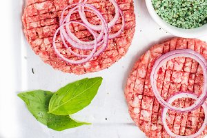 Three raw ground beef meat cutlets