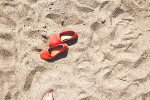 Red espadrilles in the sand