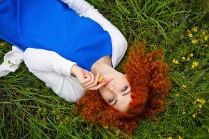 Girl lying in a meadow