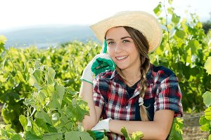 Pretty woman farmer in the vineyard
