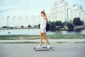 young girl using longboard