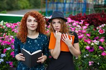 Girlfriends read book in the park