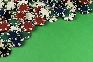 gambling coins isolated on green