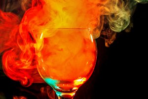 Orange smoke in a glass. Halloween.