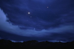 night sky above the mountains.