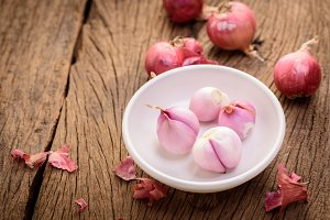 red onions on a wooden background