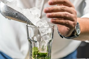 Bartender pouring ice