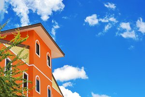 Orange house on blue sky.