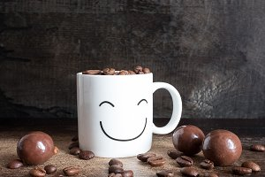 White coffee mug with coffee grains