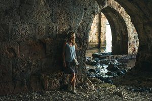 Woman standing in ancient shipyard