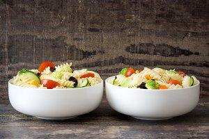 Pasta salad on wooden background