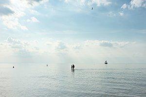 People walk on the sea